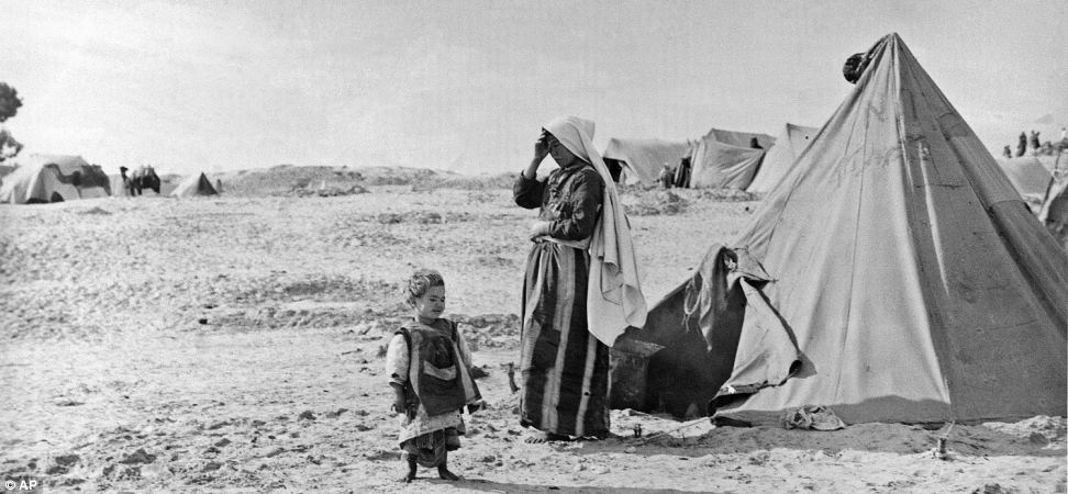 In this 1948 photo from the U.N. Relief and Works Agency, UNRWA, archive, Palestinian refugees stand outside their tent in Khan Younis, Gaza Strip