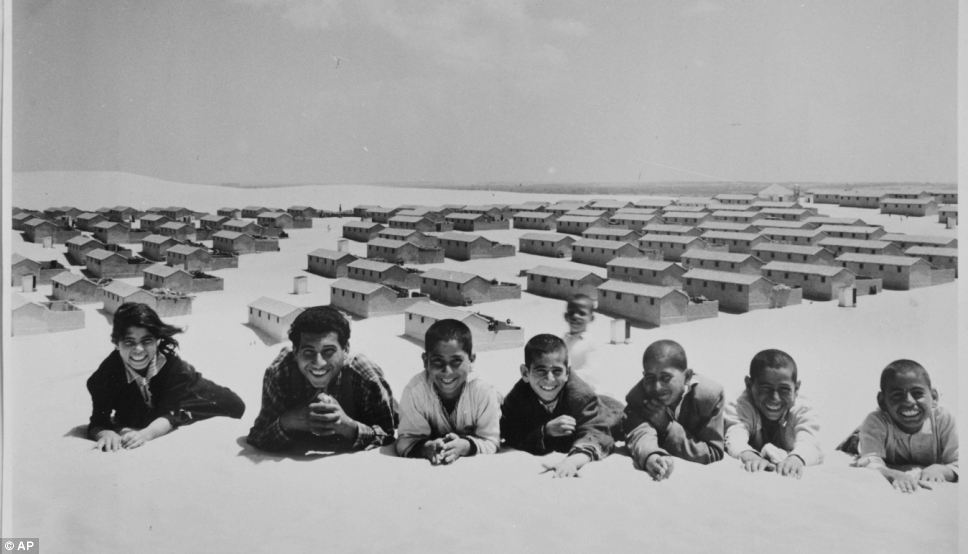 In this 1971 photo from the UNRWA archive, Palestinian refugees pose for a picture in the New Amman refugee camp in Eastern Jordan