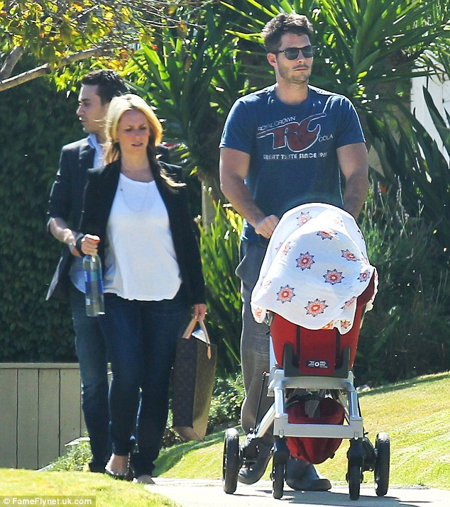 Family time: The actress enjoyed a short stroll with Brian Hallisay and their baby daughter Autumn before heading to a meeting in Los Angeles