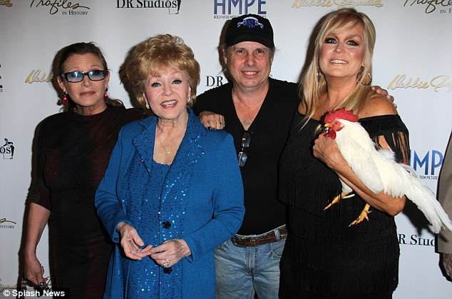 It's a family affair: Carrie was joined  by her brother Eddie and his wife Catherine Hickland for the event