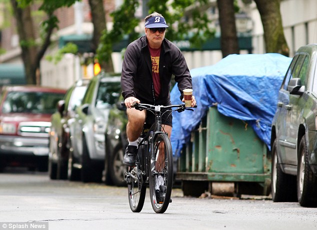 Riding the right way this time? Alec Baldwin was seen cycling in the right direction on Thursday in NYC following his arrest on Tuesday