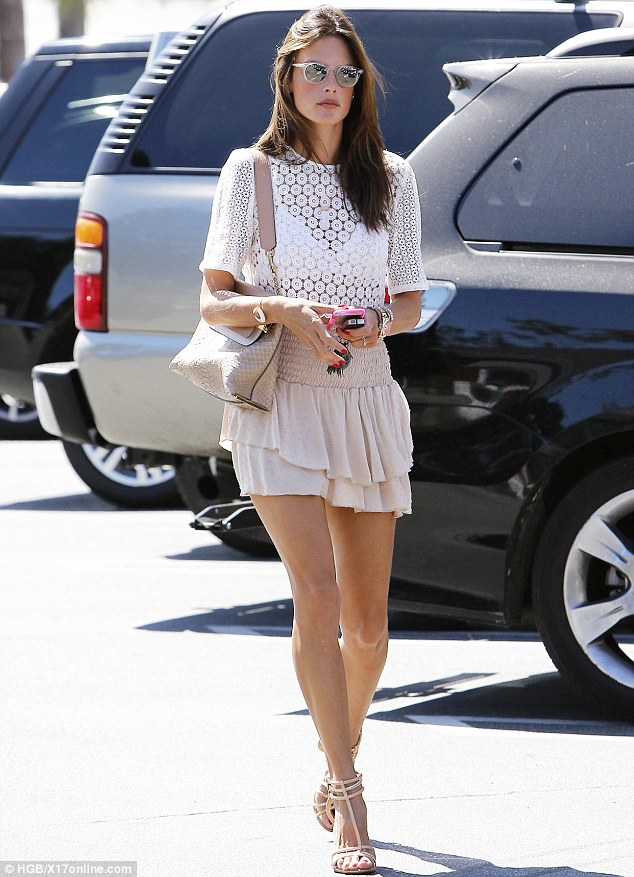 Beating the heat: Alessandra Ambrosio donned minimal clothing as she stepped out at the Brentwood Country Mart in Brentwood, California on Wednesday