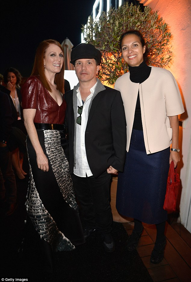 Time to let their hair down: Julianne, Olivier Dahan and Isabelle Giordano have a blast