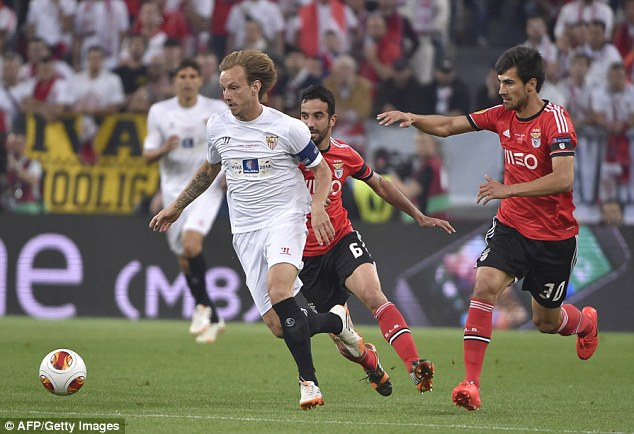 Closely followed: Rakitic runs with the ball as he produces a man-of-the-match performance