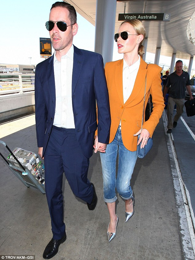 Still loved up: Kate and 43-year-old Michael, who married last August, held hands as they walked around LAX