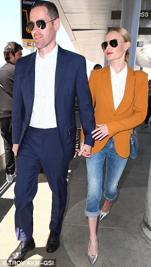 From one runway to another: The couple were headed to Singapore for the four-day Audi Fashion Festival