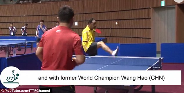 Inspirational: Mr Hamato serves against former world champion Wang Hao by flicking the ball up with his foot
