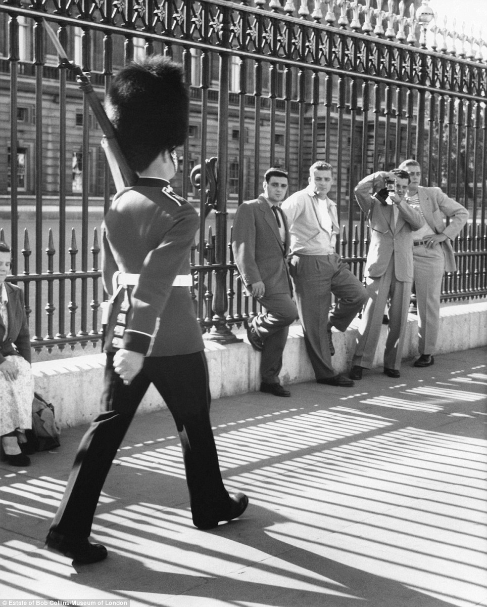 All change, please: A Royal Guard marching outside Buckingham Palace during the Changing of the Guard in around 1955. A series of street photographs of London life by Bob Collins, who rose to fame for his depictions of celebrities including singer Shirley Bassey and comedian Tony Hancock, has gone on display at the Museum of London