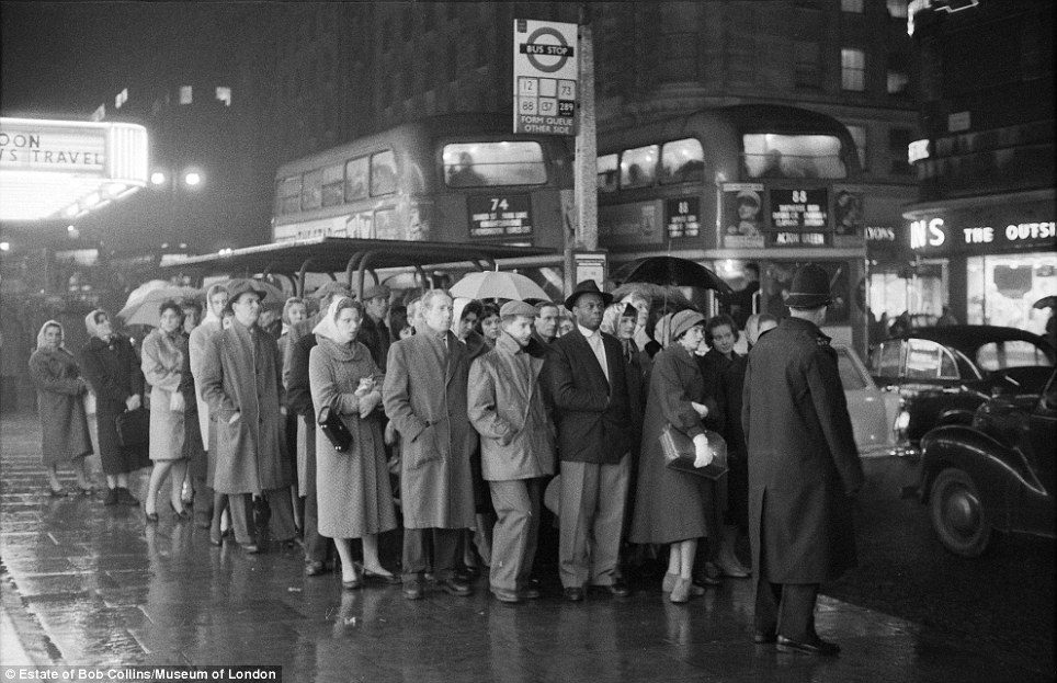 Familiar sight: Many things have changed in central London since 1960, but some things have remained depressingly similar - including the capital's wet weather