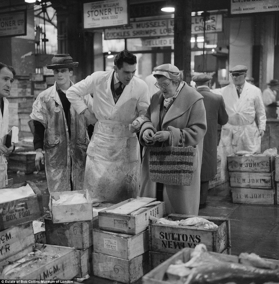Documentary: The photographer adopted a candid style but occasionally one of his subjects would catch his eye, such as in this photo at Billingsgate fish market