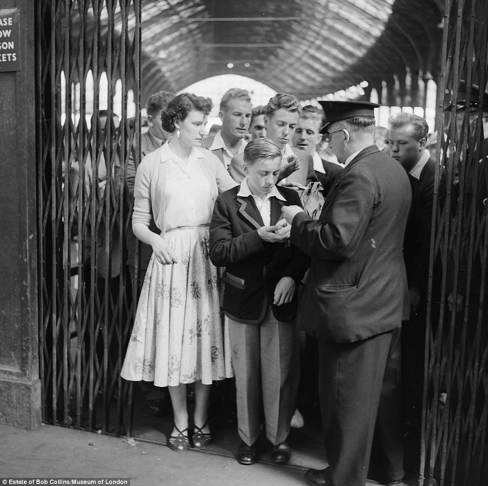 Queuing: Some British traditions will never die. Before the days of automated ticket gates, these crowds huddled towards a single inspector at Victoria station in 1960