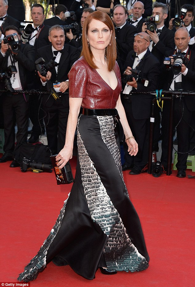 Hell for leather: Julianne Moore looked radiant in her burgundy top and bias-cut skirt as she attended the Mr Turner movie premiere in Cannes on Thursday evening