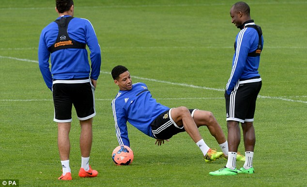 Preparation: Davies (centre) shares a joke with Aluko (right) and Livermore during training