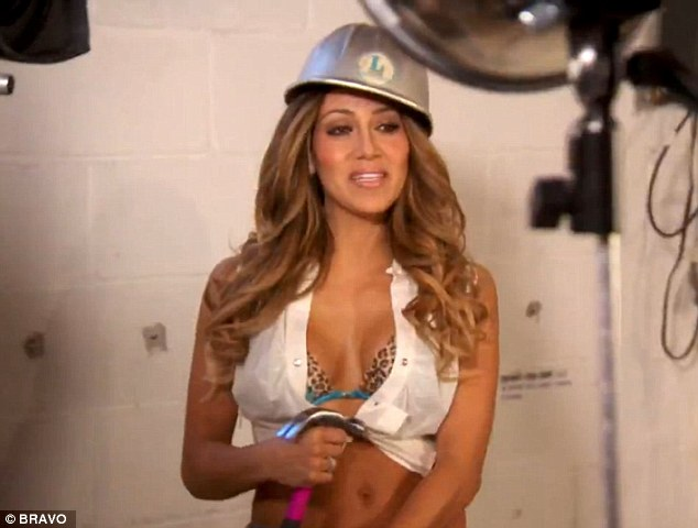Something to ponder: Melissa Gorga dresses like a construction worker for a lighter bit on the reality series