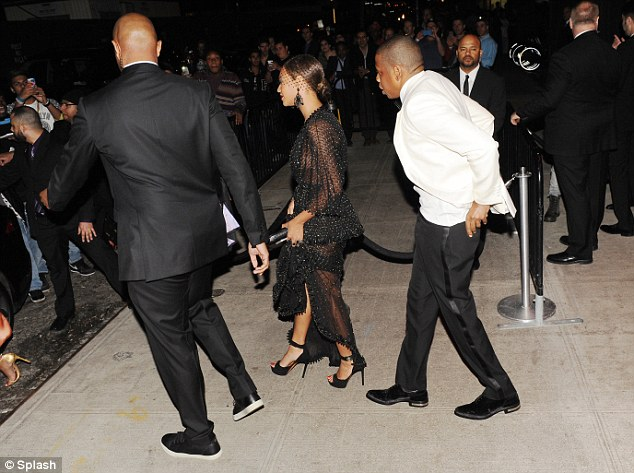 Recovering himself: Jay Z was seen straightening himself out following the attack as he and Beyonce made their way to their cars