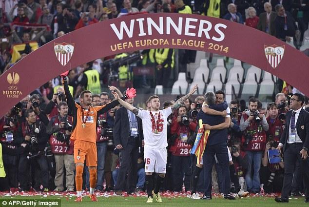 Euro glory: Sevilla defender Alberto Moren (centre) raises his hands after winning the Europa League