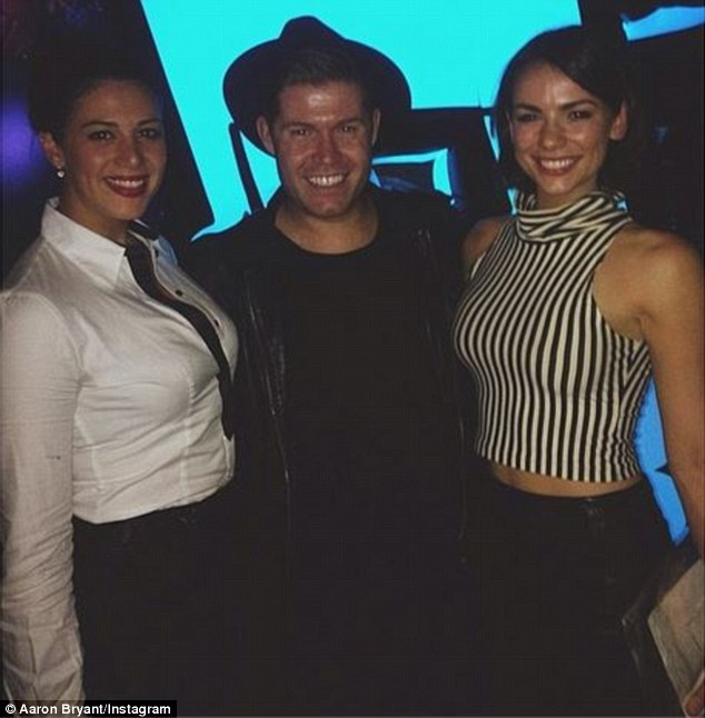 Very secretary: Rather formally dressed for the casual affair in a crisp white shirt, pencil skirt and tie, the Olympic champion was accompanied by model Maddy King and friend Aaron Bryant with the latter posting a group shot to Instagram