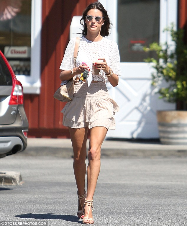 Perking up: Alessandra picked up a coffee during her outing