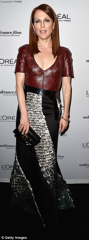 When one outfit simply isn't enough: The actress was well and truly rocking the red carpet as she strutted her stuff in a vampy plunging red leather and black satin gown earlier in the evening - before switching into her feminine strapless number
