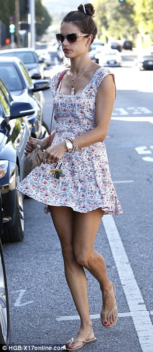 Easy does it: Alessandra opted for a lightweight floral frock as she stopped by the Brentwood Country Mart Thursday