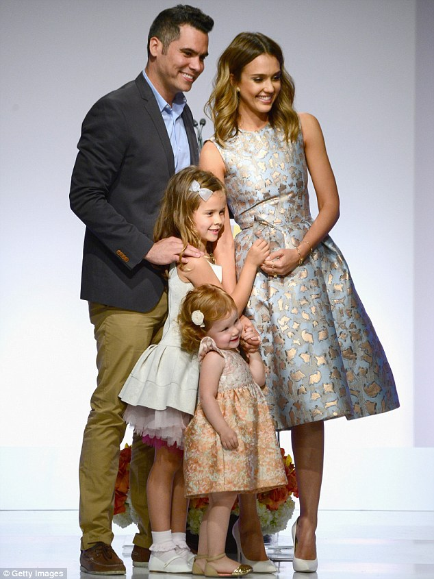 Happy family: Jessica with Cash Warren and their daughters Honor and Haven at The Helping Hand of Los Angeles Mother's Day Lunch at the Beverly Hilton on May 9 where the actress was named Mother Of The Year