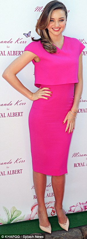 Flattering: The magenta dress featured a cropped sheath on top to a slimming effect
