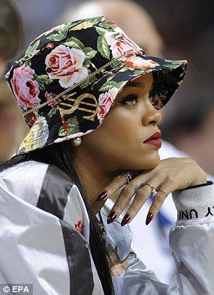 Trendsetter: Rihanna is known for championing trends long before they become fashion hits - and it looks like the bucket hat is back
