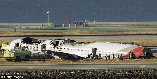 The Asiana Airlines Boeing 777 on the runway at San Francisco International Airport on July 6, 2013 after it crashed upon landing, killing three