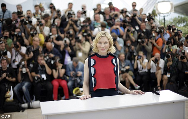 Commanding attention: Cate looked more than comfortable in front of the hundreds of photographers