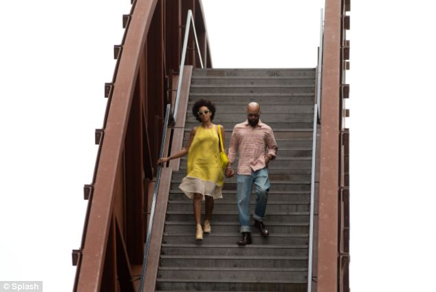 Crossing over: The duo traversed the river hand-in-hand