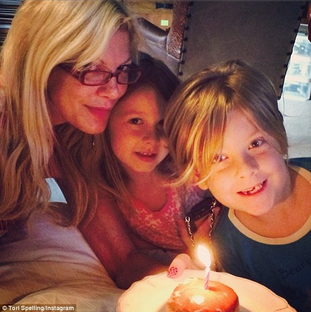 'They asked me to make a wish...which I did right away': Her seven-year-old son Liam and daughter Stella, who turns six next month, also got her 'my fave kind of donut'