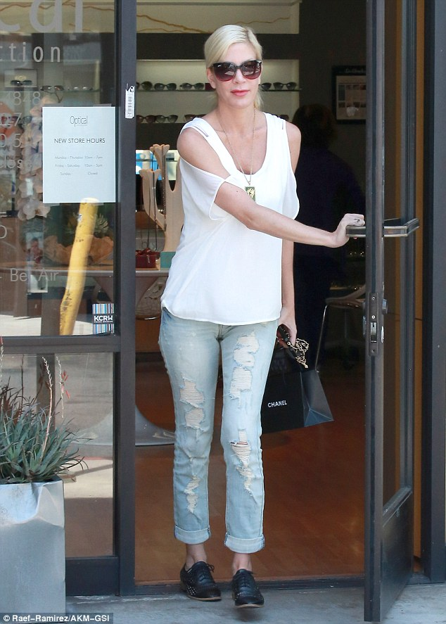 Low-key celebration: Tori Spelling spent her 41st birthday with a solo trip to Optical Connection in Studio City Friday