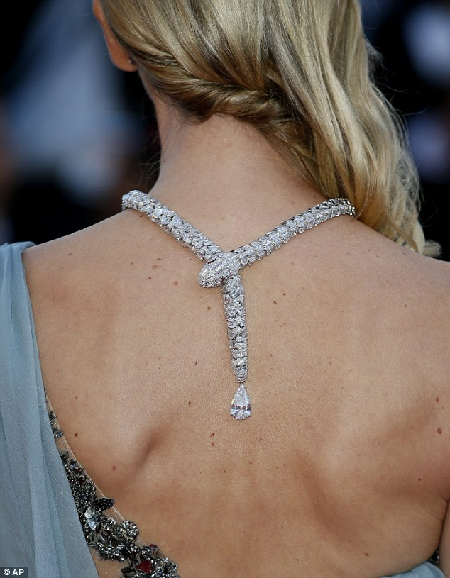 Back beauty: The star wore a bejewelled snake around her neck as she teetered along the red carpet