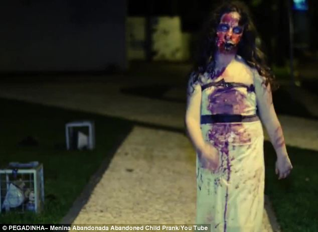 Earlier in the film  the child is seen in full - with blood running down her face on to her white dress