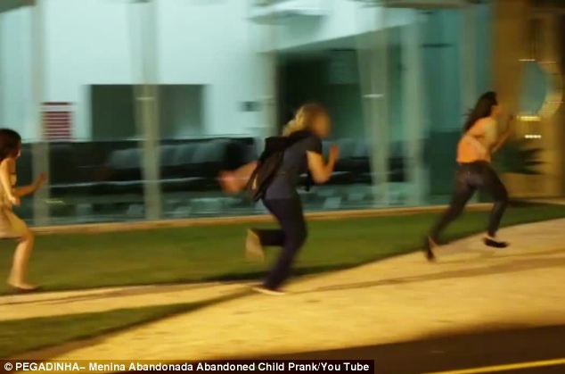 The terrified Good Samaritans flee in terror - as the girl, wearing a bloodied dress, runs after them