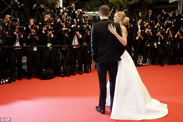 Gorgeous in monochrome: The pair were one smart looking couple as a horde of photographers snapped away