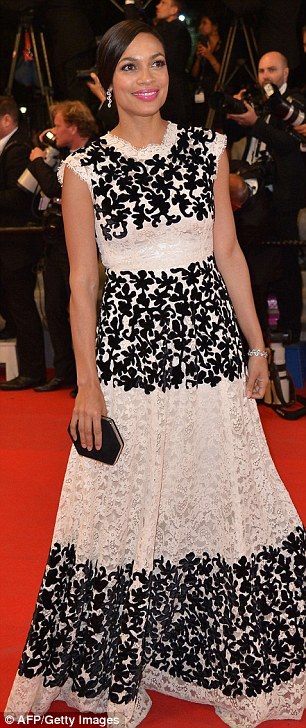 Another glamorous arrival: Rosario Dawson also wore a monochrome dress