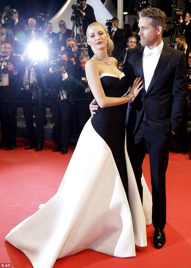 Smitten: Ryan could not take his eyes off Blake as she posed for photographs