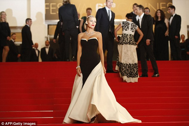 One last look: The actress glanced one last time over the sea of press before joining her husband of two years inside the premiere