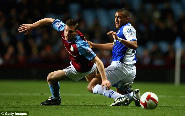 Benchwarmer: A rare appearance for Simpson (right), during his loan spell at Blackburn Rovers