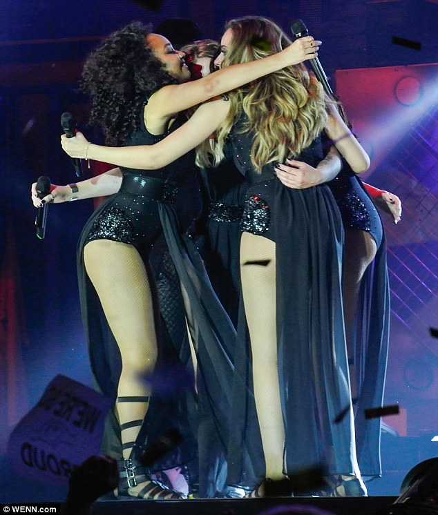 Teamwork: The girls shared an embrace on the stage as they celebrated their first night on tour