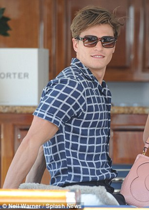 Stylish: Handsome Oliver takes it easy after the pair climb aboard a yacht on Saturday