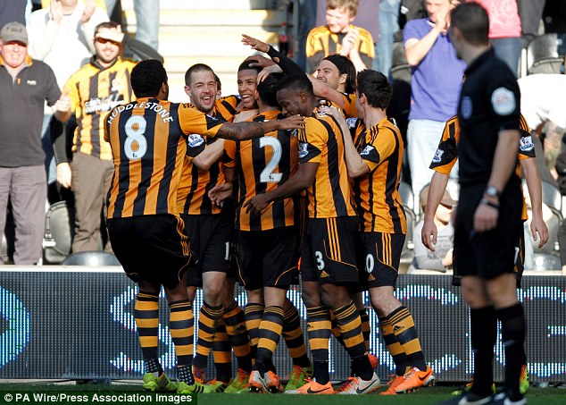 Team effort: Curtis Davies (third left) is congratulated after scoring in Hull's 3-0 victory over Sunderland