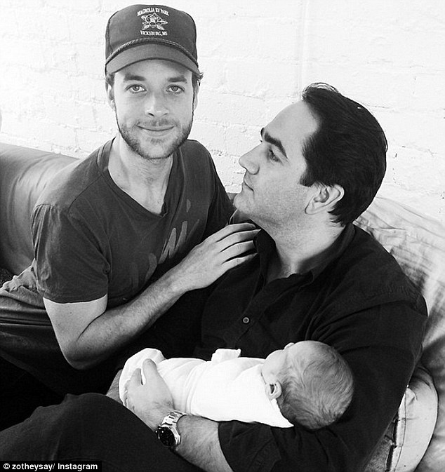 Two and a half men: Hamish Blake and Michael 'Wippa' Wipfli pose for a goofy family portrait style shot with Hamish's one-week-old baby boy Sonny on Instagram on Saturday