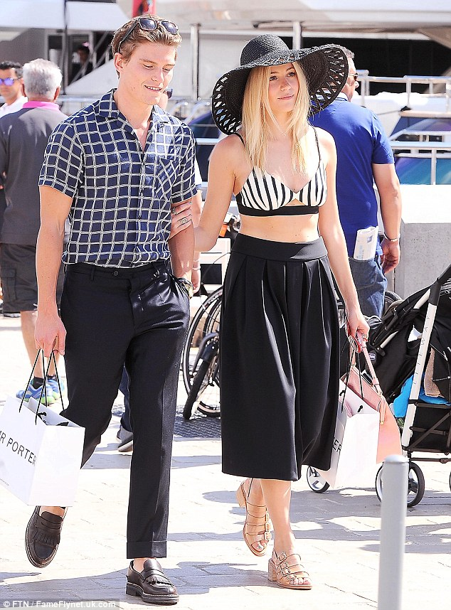 Stylish pair: The couple certainly had their resort wear wardrobe down to perfection