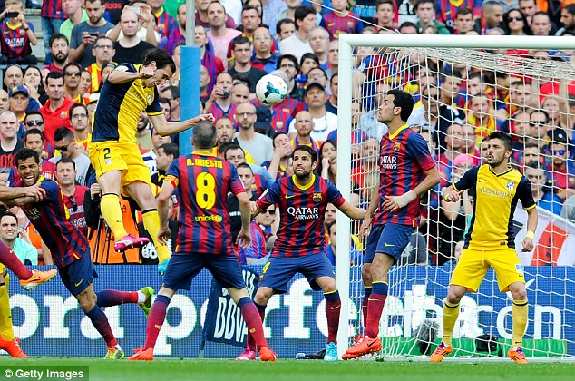 Decisive moment: Diego Godin (second left) scored Atletico's equaliser in their 1-1 draw on Saturday