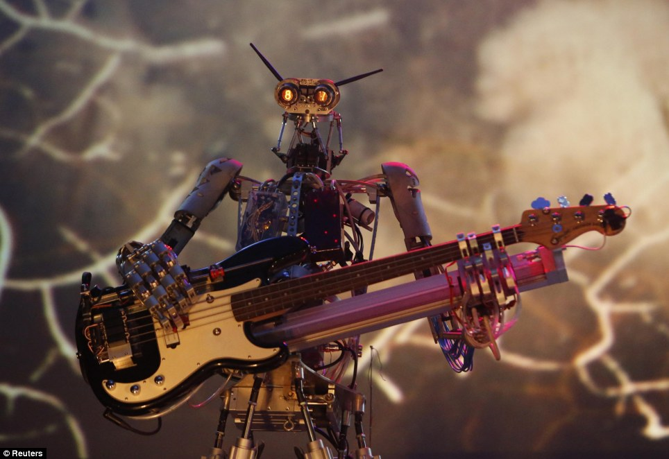 Rock on: Compressorhead took the stage at the Robot Ball exhibition at ARTPLAY Center for Design in Moscow this weekend where dozens of robots from across the globe will be shown to the public