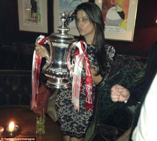 Poser: Bacary Sagna's wife Ludivine Sagna posed with the FA Cup after Arsenal's win on Saturday