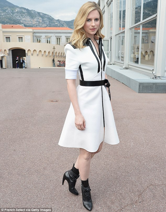 Mixing it up: Actress Brit, 30, also wowed in her white dress, complete with black trim, which she teamed with pointy ankle boots