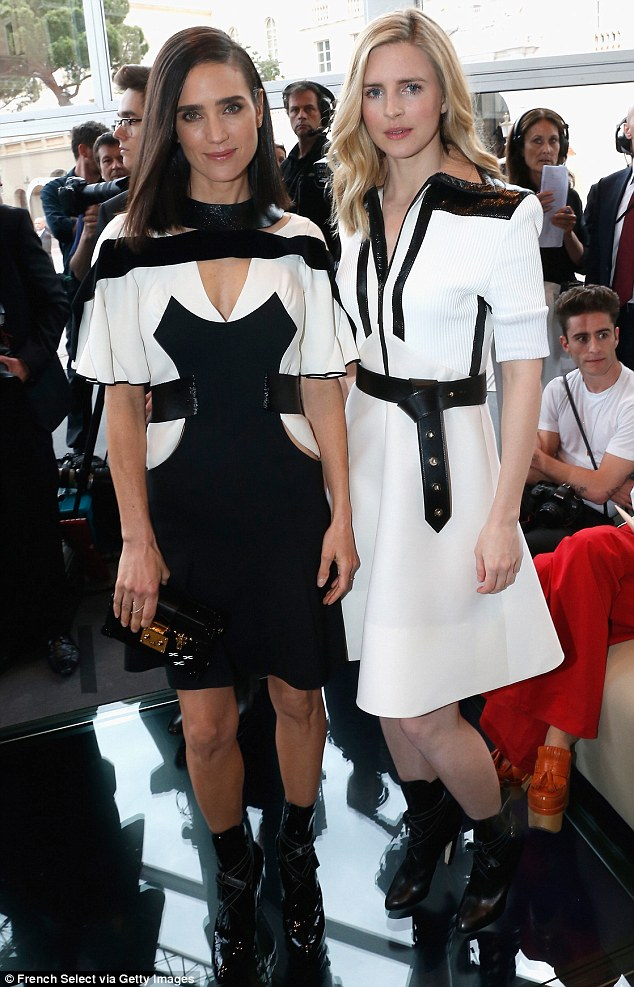 Perfectly coordinated: The US actress, pictured with Brit Marling, undoubtedly turned heads in her unique cut-out number featuring silhouette detailing on the front